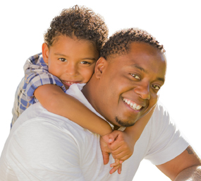 Happy African American Father and Mixed Race Son Playing Piggyba