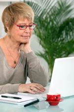 Grandmother using laptop_150x225