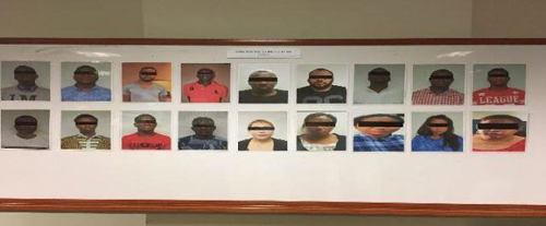 Suspects arrested in Malaysian love scam raids. (Photo by SPF)