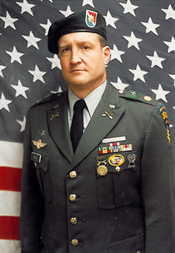 "Maj. ""Roger"" Mills in 1996, when he served in the Army Reserve."